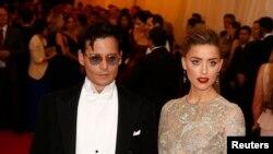 Aktor Johnny Depp dan tunangannya Amber Heard di Metropolitan Museum of Art. (Reuters/Lucas Jackson)
