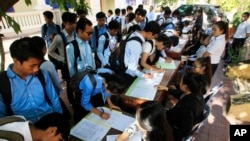 Students register to participate in a campaign by the National Election Committee, NEC, in Phnom Penh, Cambodia, Wednesday, May 9, 2018. NEC on Wednesday held its campaign with the teachers and students on the disseminate awareness of the law on the organization and functioning of the election law for the 2018 general election. (AP Photo/Heng Sinith)