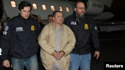 FILE - Mexico's top drug lord Joaquin 'El Chapo' Guzman is escorted as he arrives at Long Island MacArthur airport in New York, Jan. 19, 2017, after his extradition from Mexico.