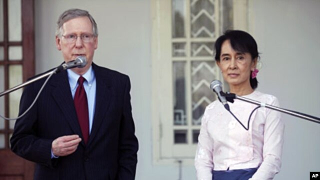 U.S. Senator Mitch McConnell (R-KY) (L) talks to reporters after meeting Burma's pro-democracy leader Aung San Suu Kyi at her home in Yangon, January 16, 2012