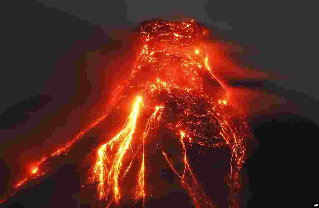 The Mayon volcano spews molten lava, Jan. 25, 2018, during its sporadic eruption in the early morning outside Legazpi city, Albay province, around 340 kilometers (200 miles) southeast of Manila, Philippines.