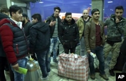 FILE - Afghans who were deported from Germany arrive at Kabul International Airport, Kabul, Afghanistan, Dec. 15, 2016.