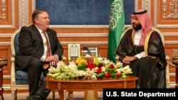 FILE - Secretary of State Michael R. Pompeo meets with Saudi Crown Prince Mohammed bin Salman, in Riyadh, Saudi Arabia, Oct. 16, 2018.