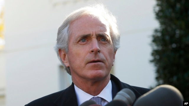 Senator Bob Corker, ranking Republican on the Senate Foreign Relations Committee, speaks to members of the media outside the West Wing of the White House, Nov. 19, 2013, following a meeting with President Barack Obama.
