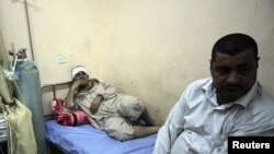 A man wounded in a bomb attack lies at a hospital in Kerbala, 110 km (70 miles) south of Baghdad, June 13, 2012.