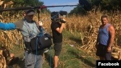 Romanian filmmaker Mihai Dragolea, center, shoots an interview for a documentary, in a photo posted on his Facebook page Sept. 28, 2021.