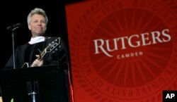 Rock star and philanthropist Jon Bon Jovi performs a new song during graduation ceremonies at Rutgers University-Camden Thursday, May 21, 2015, in Camden, N.J.
