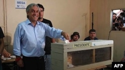 Right-wing candidate Sebastián Piñera votes in Chile.