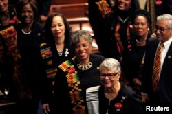 Democratic female members of Congress, wearing black to support the #MeToo movement and buttons referring to 1944 rape victim Recy Taylor, arrive on the House floor to watch U.S. President Donald Trump deliver his State of the Union address.
