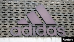 The logo of Adidas is seen on an outlet store in Metzingen, Germany, June 16, 2017.