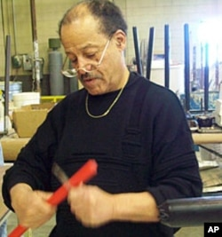 Ed Dwight at work in his studio, preparing the supports for a bronze casting.