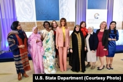 The recipients of the 2018 International Women of Courage awards gather for a group photo with first lady Melania Trump, March 23, 2018, at the State Department in Washington.
