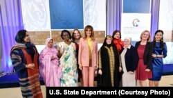 The recipients of the 2018 International Women of Courage awards gather for a group photo with first lady Melania Trump, March 23, 2018, at the State Department in Washington. From left are Roya Sadat, of Afghanistan, L'Malouma Said, of Mauritania, Godeli