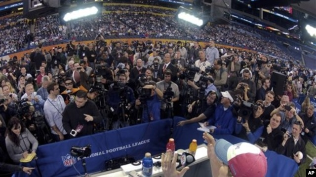 New York Giants quarterback Eli Manning answers questions during Media Day for NFL football's Super Bowl Jan. 31, 2012