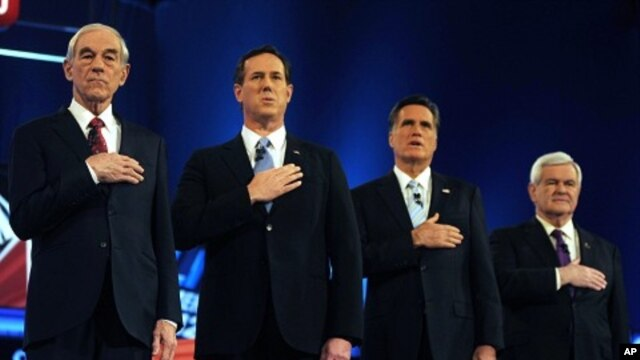 U.S. Republican presidential candidates (L to R) U.S. Rep. Ron Paul, former U.S. Senator Rick Santorum, former Massachusetts Governor Mitt Romney and former Speaker of the House Newt Gingrich stand for the National Anthem before the start of the Republica