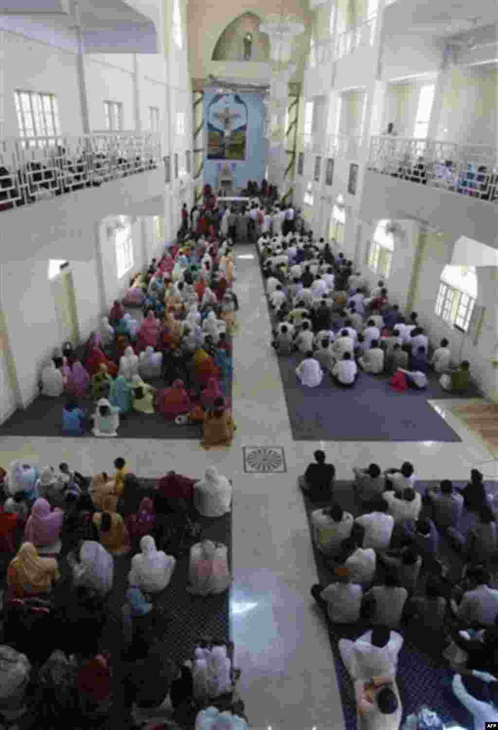 In this Nov. 14, 2011, photo, people from the Pakistani Christian community attend a Sunday service at St. Peter's church in Karachi, Pakistan. Pakistan's tiny and underfire Christian community thought big when constructing its latest church _ a domed, th