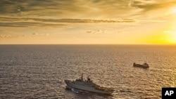 A Swedish warship escorts a merchant vessel off the coast of Somalia (file photo)