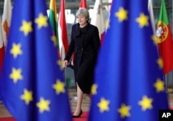British Prime Minister Theresa May arrives for an EU summit at the Europa building in Brussels, Dec. 14, 2017.