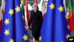 British Prime Minister Theresa May arrives for an EU summit at the Europa building in Brussels, Belgium, Dec. 14, 2017.