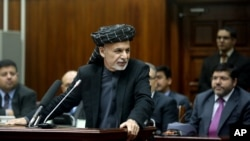 Afghan President Ashraf Ghani speaks during a ceremony at the parliament in Kabul, Afghanistan, Jan. 20, 2015.
