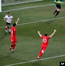 England's Wayne Rooney (bottom right) and teammate England's Frank Lampard (second from left) react after a referee disallowed Lampard's goal during the World Cup soccer match between Germany and England, in South Africa, June 27, 2010.