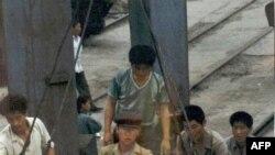 Международная продовольственная помощь в одном из портов Северной Кореи. Архивное фото.