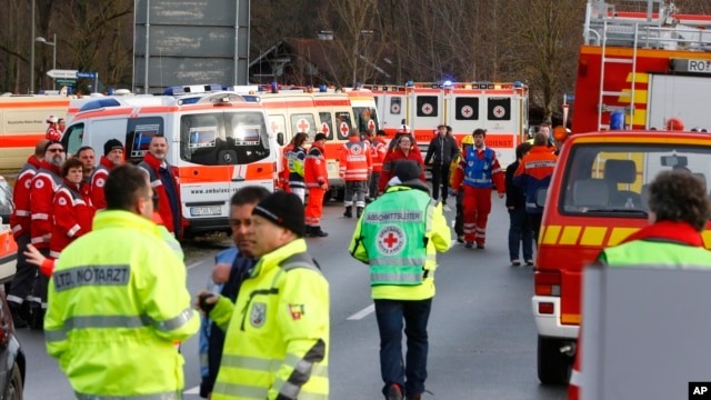 Rescue personnel wait in Bad Aibling, Germany, after two regional trains crashed, Feb. 9, 2016.