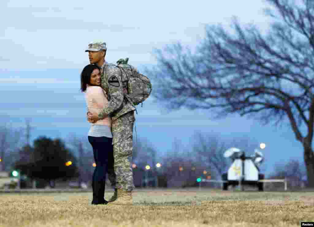 Private Devin Alderman from the 3rd Brigade, 1st Cavalry Division hugs his girlfriend, Gislaine Powers, during a homecoming ceremony at Fort Hood, Texas December 21, 2011. (Reuters)