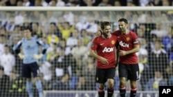 Michael Owen (kiri) semasa masih bergabung dalam klub Manchester United (foto: dok.)