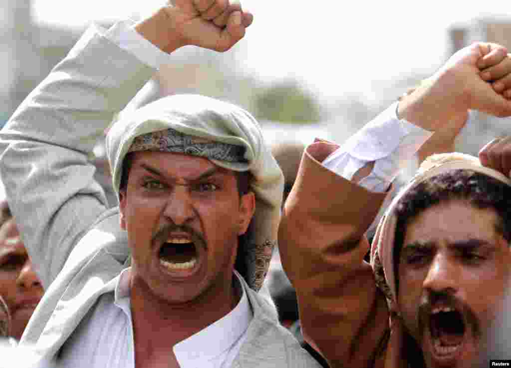 On a road leading to the U.S. embassy in Sanaa, protesters shout slogans against the anti-Islam film made in the U.S. mocking the Prophet Muhammad, September 21, 2012.