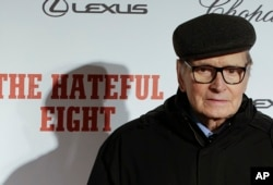 "FILE - Composer Ennio Morricone arrives for the screening of the movie ""The Hateful Eight,"" in Rome, Jan. 28, 2016."