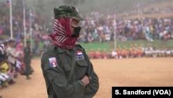 A Karen National Police Force officer watches the Karen Revolution day ceremonies Jan. 31, 2019, in Karen state, Myanmar, near the Thai-Myanmar border.