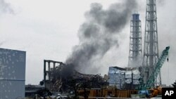 FILE - Smoke is seen coming from the Fukushima Daiichi nuclear power plant in northeastern Japan, March 21, 2011.