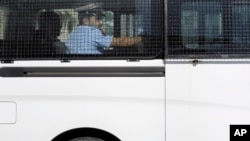 A prison van believed to be carrying some of the four detained American journalists leaves the Public Prosecution offices in Manama, Bahrain, Feb. 16, 2016.