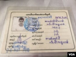 "A ""White Card"" identification document returned to immigration authorities by a Rohingya man. (Colin Lovett/VOA)"