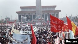 FILE - Hundreds of thousands of people fill Peking's central Tiananmen Square, in front of the Monument to People's Heroes and Mao's mausoleum in the biggest popular upheaval in China since the Cultural Revolution of the 1960's, May 17, 1989.