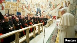 Pope Benedict XVI (R) speaks to Cardinals during the closing day of the Spiritual Exercises at the Vatican, February 23, 2013.