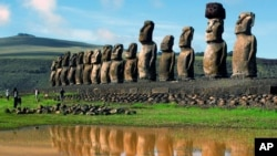 FILE - Giant volcanic rock statues called Moais are shown on Easter Island in the South Pacific.