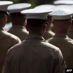 U.S. Marines march in a parade in Honolulu in December to honor Japanese-American veterans of World War Two. Xavier Alvarez claimed he was a retired Marine who won the Medal of Honor.