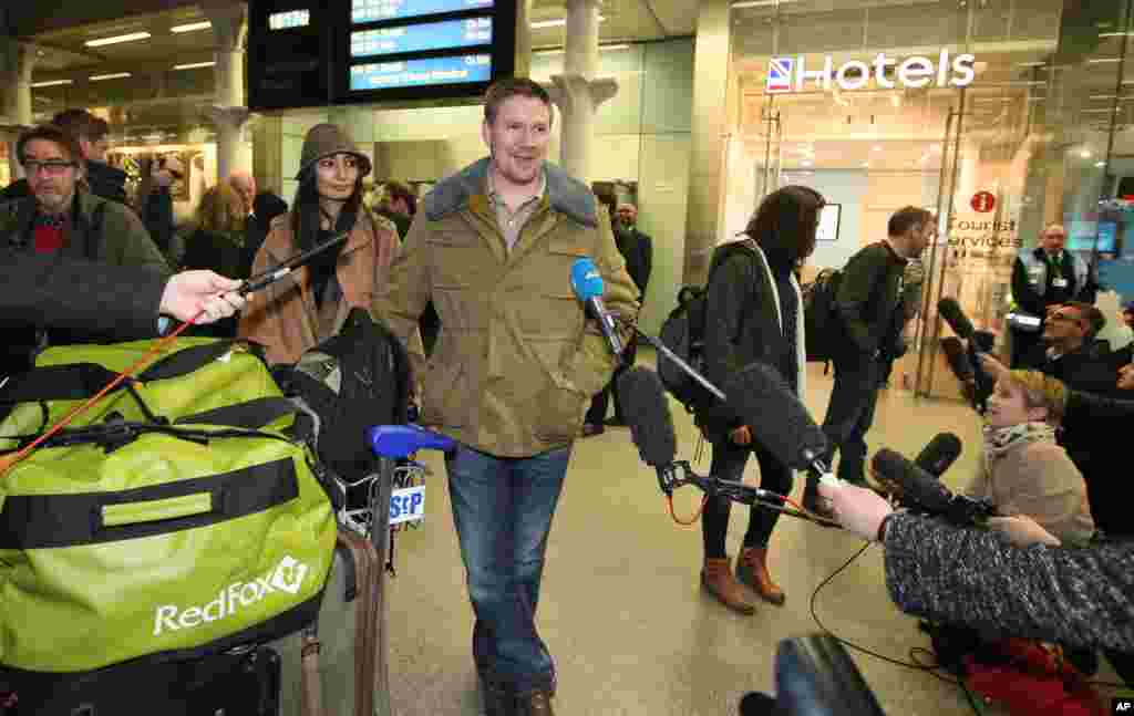 Anthony Perrett, an activist and one of the 30 Greenpeace crew arrested in the Russian Arctic, talks to the media after he arrives back in London, England, Dec. 27, 2013.