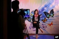 Karishma Naz, music presenter on Zan TV records a show, in Kabul, Afghanistan, Aug. 22, 2019.