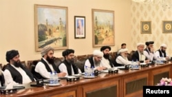 FILE - Mullah Abdul Ghani Baradar (3rd-L), who is leading a Taliban delegation, attends a meeting at the Ministry of Foreign Affairs in Islamabad, Pakistan, Oct. 3, 2019.