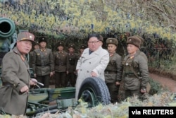 FILE - North Korean leader Kim Jong Un visits the Changrindo defensive position on the west front, in this undated picture released by North Korea's Central News Agency (KCNA), Nov. 25, 2019.