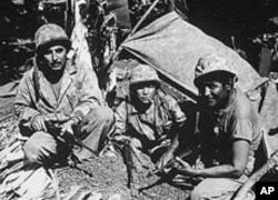 These Navajo code talkers were photographed on the Pacific Island of Saipan in 1941. Their work baffled the Japanese and helped disguise U.S. intentions and ship movements.