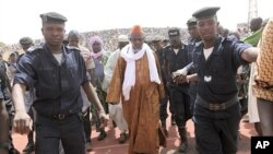 Iman Amadoun Diko (C), highly influential head of the High Council of Islam, arrives for a rally organized to calm the political situation down in Mali, at Modibo Keita stadium in Bamako, March 31, 2012.
