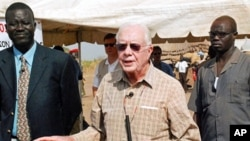 Former US president Jimmy Carter (C) during a press conference in the southern Sudanese village of Lojora , 11 Feb 2010