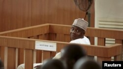 FILE - Nigeria Senate President Bukola Saraki looks on from the dock at the Code of Conduct Tribunal at Darki Biu, Jabi Abuja, September 22, 2015.