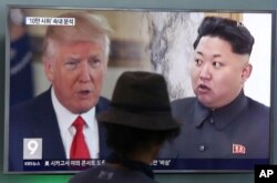 FILE - A man watches a TV screen showing U.S. President Donald Trump, left, and North Korean leader Kim Jong Un during a news program at the Seoul Train Station in Seoul, South Korea, Aug. 10, 2017.