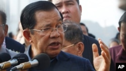 FILE: Cambodia's Prime Minister Hun Sen delivered a speech to passengers after they disembarked from the MS Westerdam, owned by Holland America Line, at the port of Sihanoukville, Cambodia, Friday, Feb. 14, 2020.