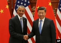 FILE - U.S. President Barack Obama, left, and Chinese President Xi Jinping shake hands at the West Lake State Guest House in Hangzhou, China, Sept. 3, 2016, on the sidelines of the G-20 summit.
